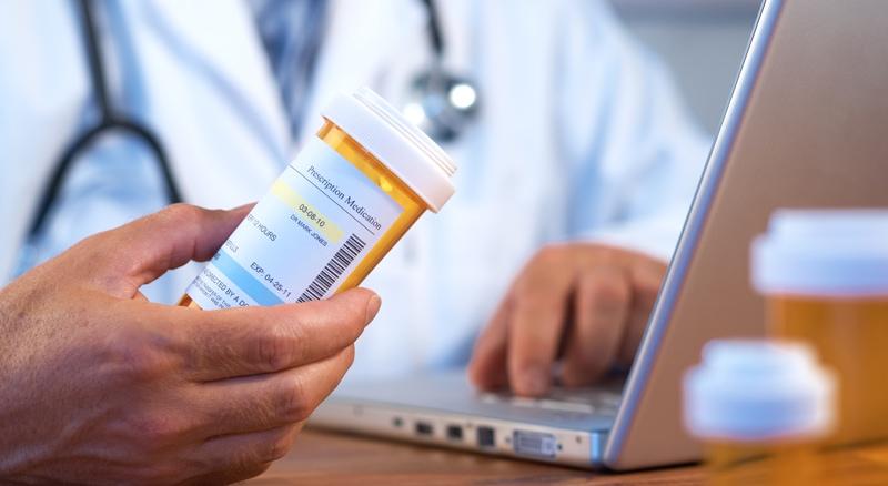 Thermal-Labels-Pharmacist-Holding-Prescription-Bottle